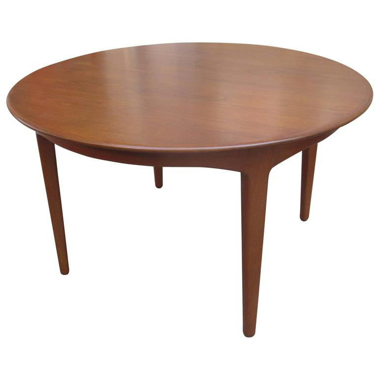 Henning Kjaernulf Teak Round Table With Four Leaves At 1stdibs
