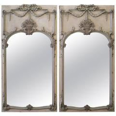 20th Century Pair of Polychrome Carved Trumeaus with Antique Style Mirrors