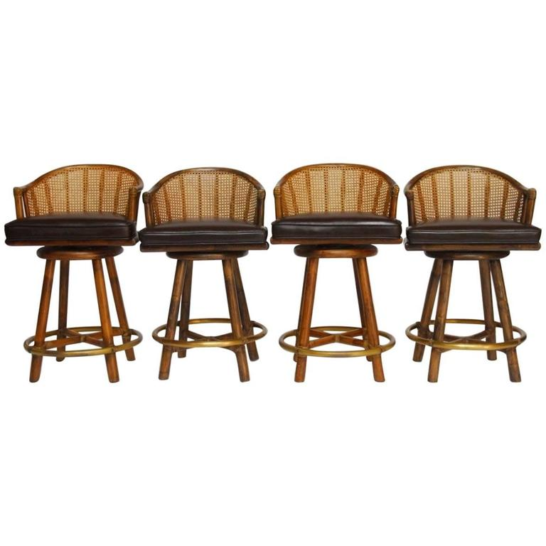 Set Of Four Mcguire Bamboo And Cane Swivel Barstools For