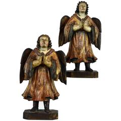 Fine Pair of Early Spanish Colonial Carved Paint and Parcel Gilt Angels