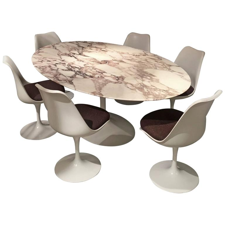 Eero saarinen calacatta marble table and tulip swivel for Dining room table with swivel chairs