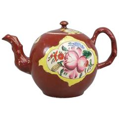 Plum Red-Ground Saltglaze Stoneware Teapot and Cover, circa 1760