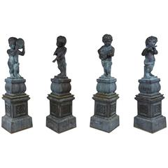 Set of Four Neoclassical-Style Cast Iron Garden Statues