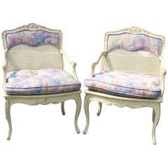Pair of Louis XVI Style Distressed Cream Painted Upholstered Fauteuils