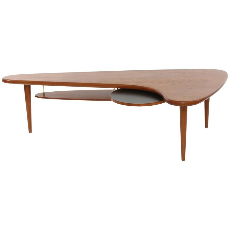 Solid teak and brass free form cocktail table at 1stdibs Solid teak coffee table