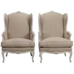 Pair of Linen Covered High Back Bergeres