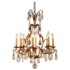 Cut Crystal and Gilded Wrought Iron Chandelier in Attributed to Baguès
