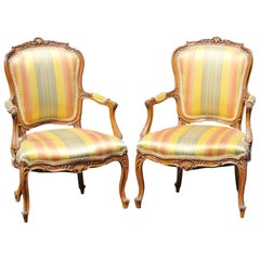 Pair of Louis XVI Style Carved Walnut Fauteuils Arm Chairs