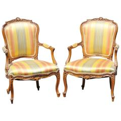 Pair of Louis XVI Style Carved Walnut Fauteuils