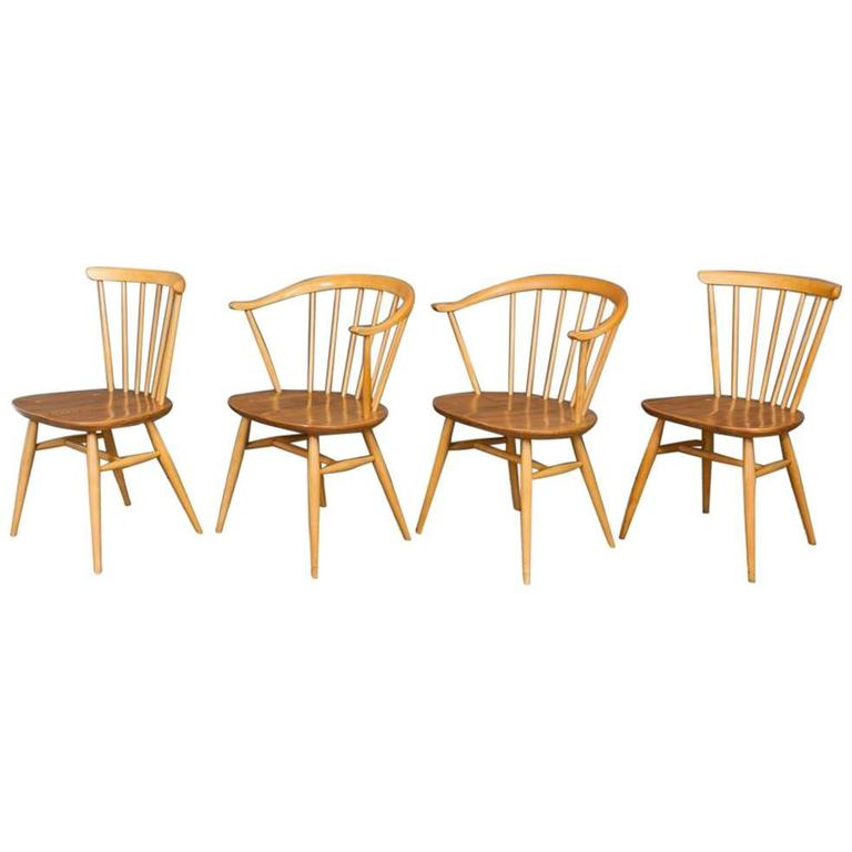 Two Ercol Cowhorn Armchairs Two Spindle Back Chairs For Sale at