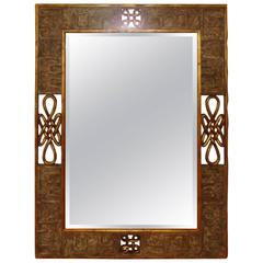 Hand-Carved Giltwood Scrolled Mirror by Harrison and Gil