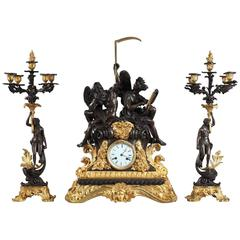 "Exceptional Napoleon III Clock ""The Use of Time"" and Pair of Candlesticks"