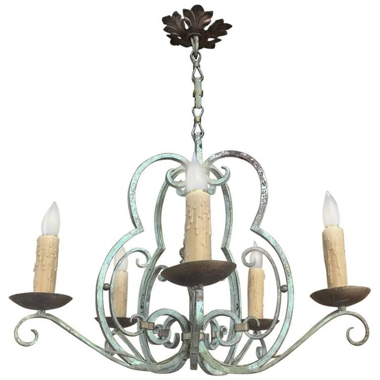 Antique country french wood and wrought iron chandelier at 1stdibs antique country french painted hand forged wrought iron chandelier aloadofball Images