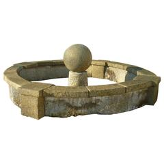 Antique Limestone Oval Basin with Thick Copings and Large Central Ball, Provence