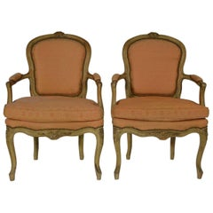 Pair of Louis XV Carved and Crème Peinte Fauteuils
