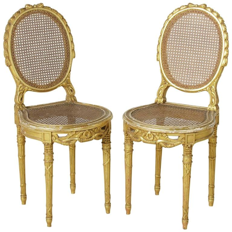 Charmant Pair Of 19th Century, Louis XVI Hand Carved Giltwood Side Chairs With Caning  For