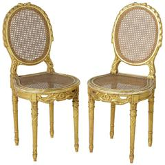 Pair of 19th Century, Louis XVI Hand-Carved Giltwood Side Chairs with Caning