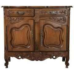 Early 20th Century Louis XV Style Hand Carved French Walnut Buffet from Provence