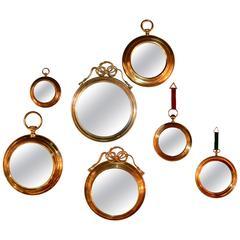 1970s Set of Seven Brass Round Mirrors