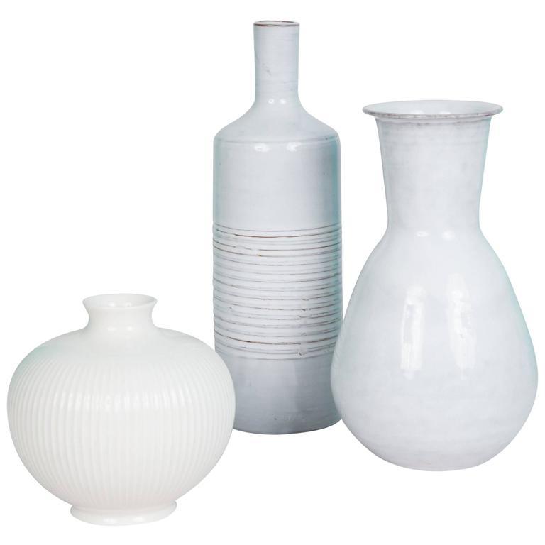 Set Of Three White Off White Continental Ceramic Vases At