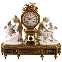 Mantel Clock Louis XVI Style with White Bisque Figures of Cupid Teaching Love