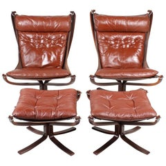 Pair of Falcon Chairs with and Ottomans in Leather