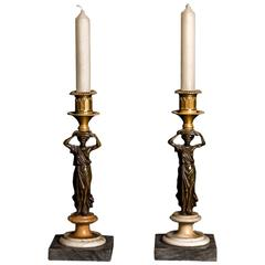 Fine Pair of Patinated and Gilt Bronze Figural Candlesticks, Early 19th Century