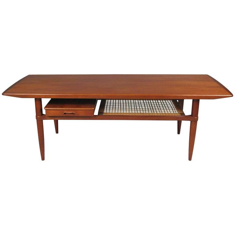 Vintage 1960s Danish Teak Coffee Table With Cane Shelf At 1stdibs
