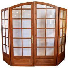 Beveled Arched Pine Bi-Fold Doors