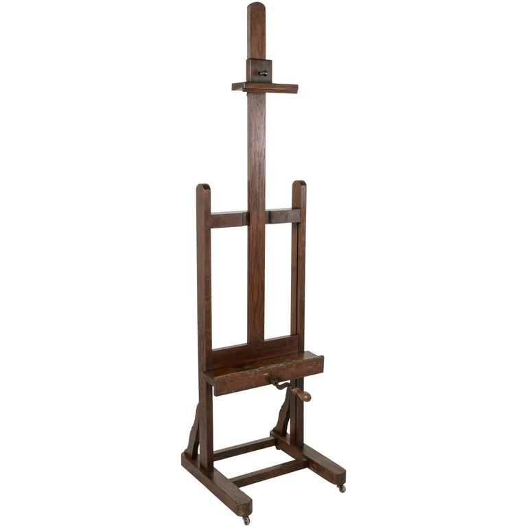 Early 20th Century French Oak Floor Easel With Adjule Tray And Crank
