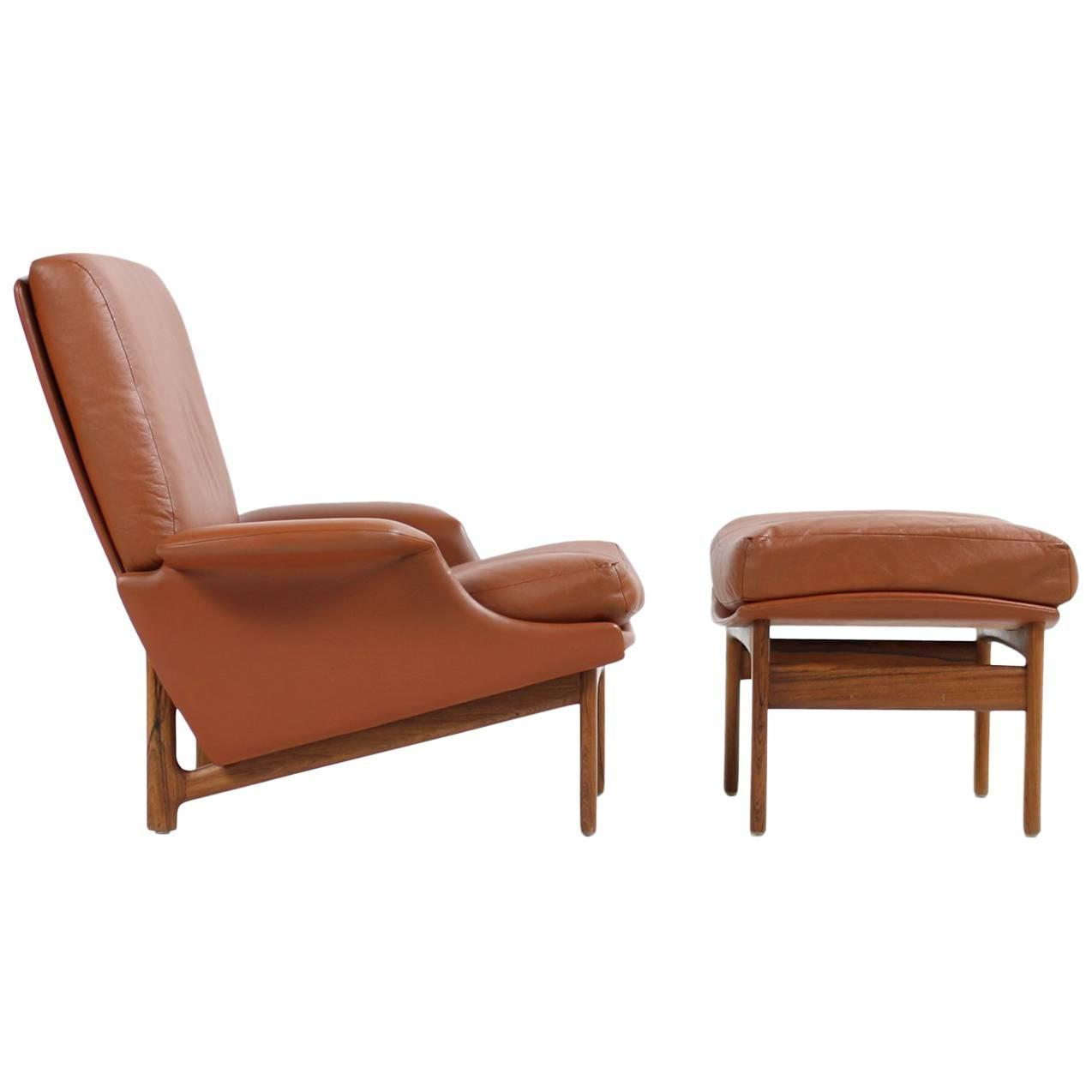 This sculptural pair of lounge chairs by ib kofod larsen is no longer - Exclusive 1960s Ib Kofod Larsen Lounge Chair Adam Rosewood And Cognac Leather For Sale At 1stdibs