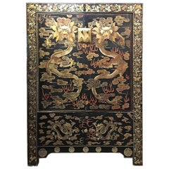 Chinese Black Lacquer Gilt Painted Dragon Cabinet, Late Qing Dynasty