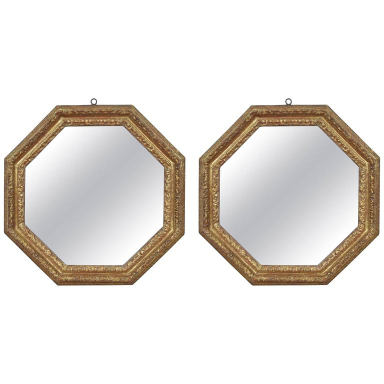 Pair of Italian Carved Giltwood Octagonal Mirrors, Late 17th-Early 18th Century
