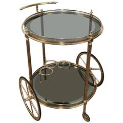 Neoclassical Style Round Brass Bar Cart with Blue Glass Attributed to Jansen