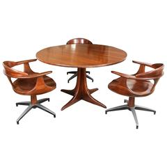 Mahogany Table with Four Swivel Armchairs in the Style of George Nakashima