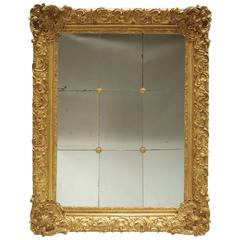 Great Regency Style Giltwood and Stucco Mirror with Rosettes, circa 1870