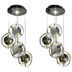 Pair of Brass, Stainless Steel and Lucite Armillary Sphere Chandeliers