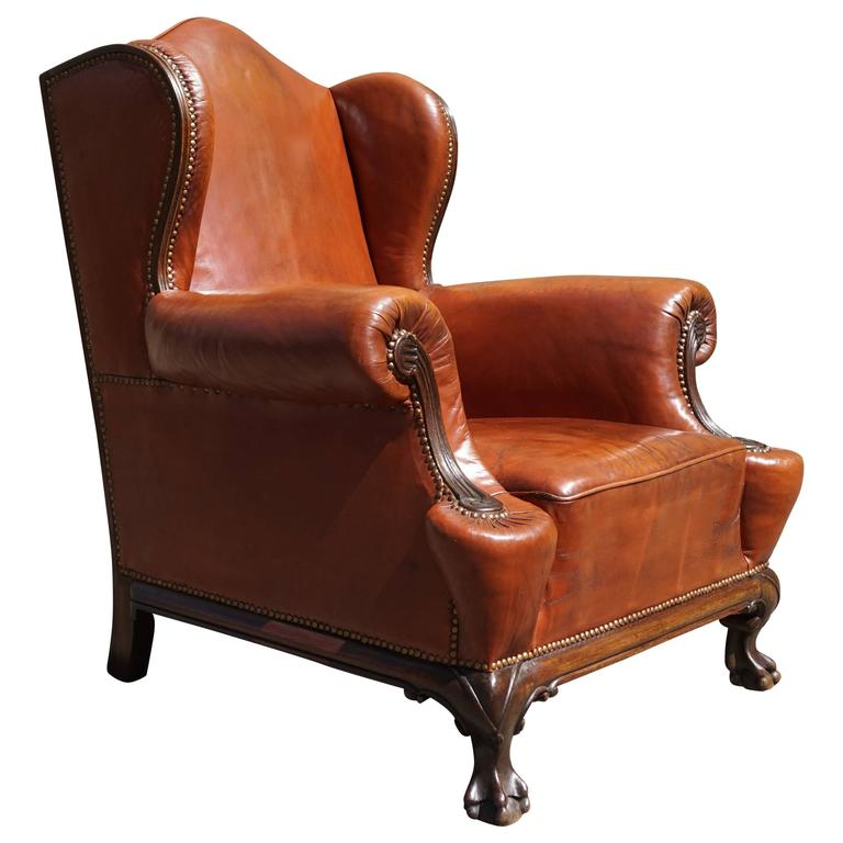 Antique Leather Chippendale Style Wingback Chair with Hand-Carved Claw Feet  For Sale - Antique Leather Chippendale Style Wingback Chair With Hand-Carved