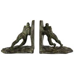 Art Deco bronze bookends pushing men Victor Demanet, 1930