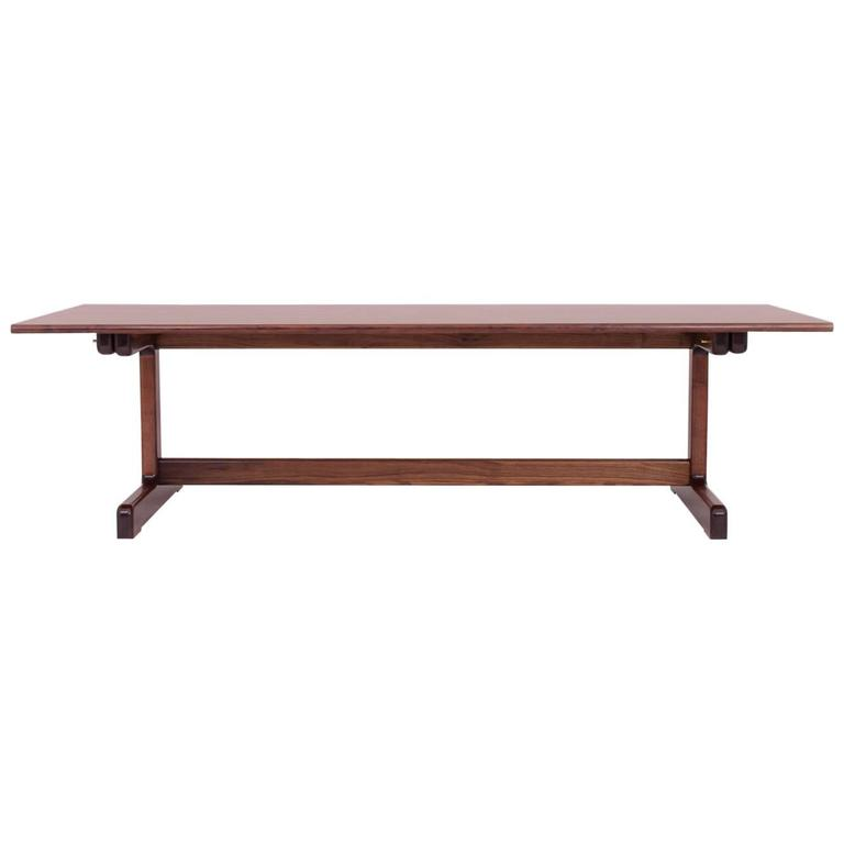 The Physalia dining table is the perfect center piece to a home or office's communal space. [Other woods available]. The clean lines provide a blank canvas for the everyday, while the soft curves feel equally smooth under your forearms or your
