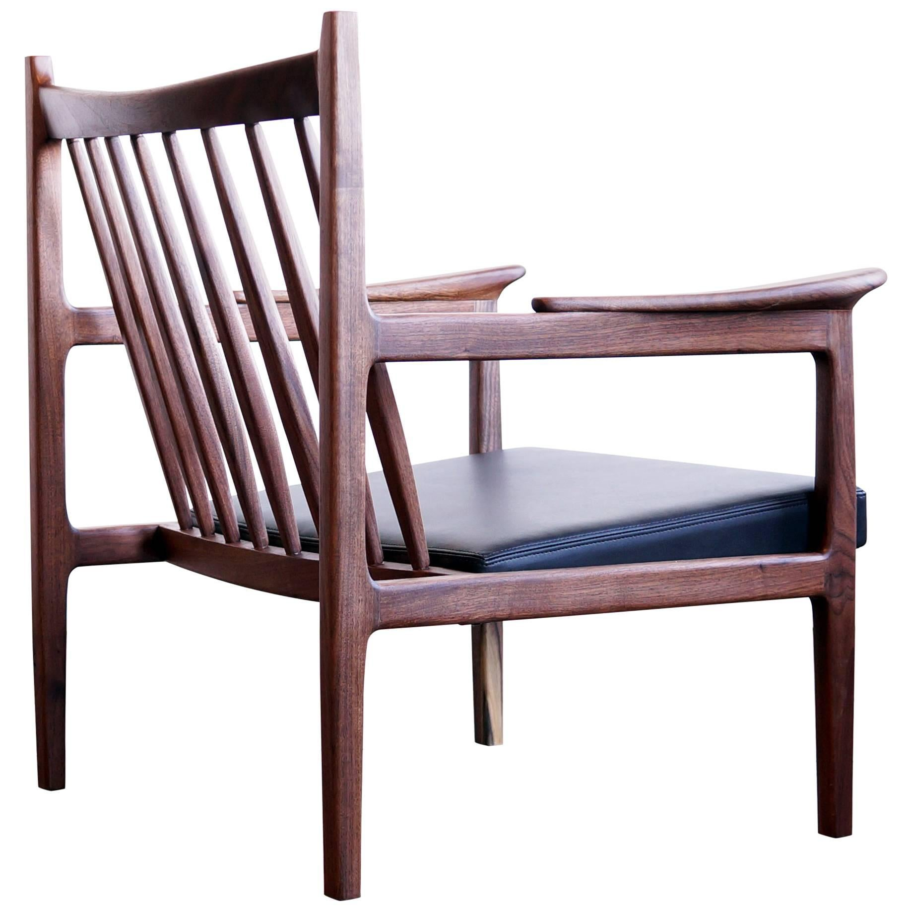 C10 contemporary handmade upholstered lounge chair in walnut and leather for sale at 1stdibs