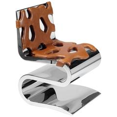 Contemporary design chair or side table in stainless steel and cognac leather