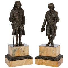 Two Patinated Bronze Sculptures of Rousseau and Voltaire after Rosset