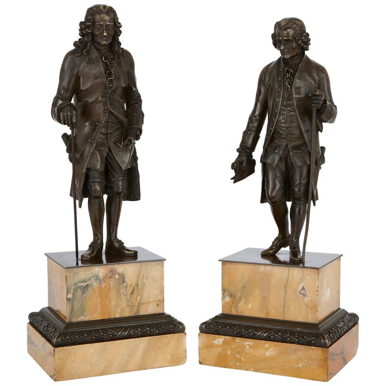 Two Patinated Bronze Sculptures of Rousseau and Voltaire after Rosset For Sale