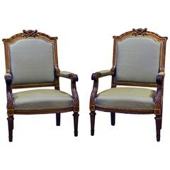 Pair of French, Louis XVI Style Carved and Parcel-Gilt Satin Covered Armchairs