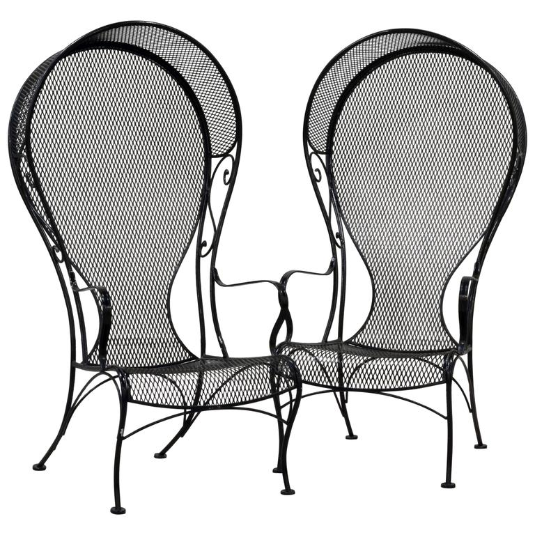 Pair of woodard mid century hollywood regency wrought iron for Mesh patio chairs