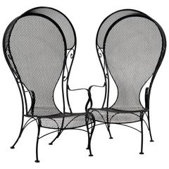 Pair of Woodard Mid-Century Hollywood Regency Wrought Iron and Mesh Patio Chairs
