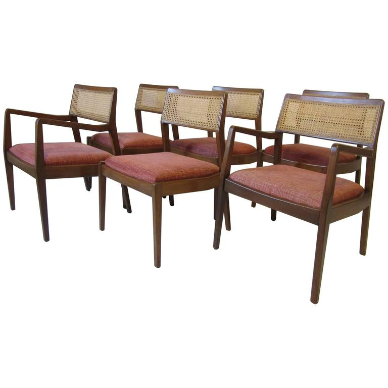 Six Jens Risom Walnut and Caned Upholstered Dining Chairs