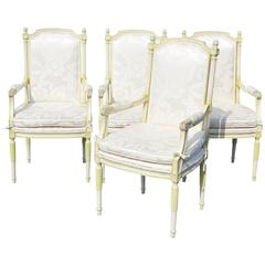 Four Louis XVI Style Distressed Cream Painted Armchairs