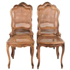 Four French Louis XV Style Cane Walnut Dining Chairs.